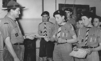 Richard Robinson and Michael Camp receiving their 1st Class Scout Badges, 1960